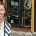 Photo shows woman outside Receiver Coffee Company