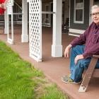 Man sitting in a chair on the veranda of a seniors building