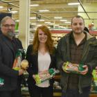 Photos shows five people holding bags of produce