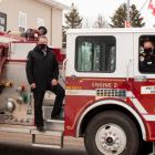 image of three people standing on a fire truck