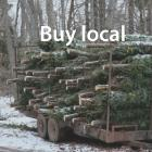 """PEI Christmas tree farm and trees baled for sale with """"Buy Local"""" badge in middle of the image"""