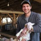 Gabriel Mercier with a spring lamb
