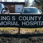 The photo shows the sign for the Kings County Memorial Hospital.