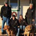 MacKinnon family and their dogs on the outside front step of their home