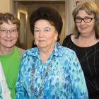 Four senior women standing beside Minister Mundy.