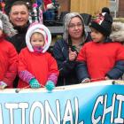 Children and adults stand behind a banner for 2018 National Child Day parade