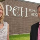Minister Robert Henderson and Dr. Michele Barton outside Prince County Hospital