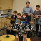 Minister Jordan Brown with music teacher Ellen Davis and students at Stratford Elementary School