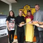 Minister Alan McIssaac and four others display Porkoberest food.