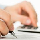 iStock image of person using calculator with PEI wordmark