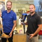 QEH prosthetic technicians Paul Hoar and Gabe Arsenault display prosthetic legs