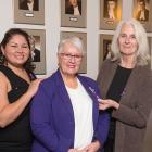 Representatives from four community organizations that will receive funding to help Island women feel safe from the threat of violence stand with Minister Paula Biggar
