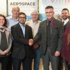 Dr. Subrata Chowdhury stands with Minister Heath MacDonald and a group of people from RPS Biologiques Inc.
