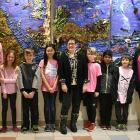 Minister Jordan Brown with artist Dina Blot, West Royalty Elementary teacher Tracey Smith and students
