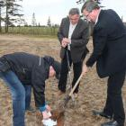 Environment Minister Robert Mitchell and Agriculture Minister Alan McIsaac bury a pair of white cotton brief to test the quality of Island soil