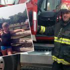 Firefighter stands with family and company truck.