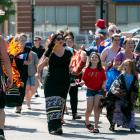 A tintamarre parade of people celebrating National Acadian Day in Charlottetown