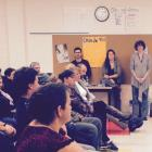 Parents attend Voir Grand workshop session to learn how to engage in their child's French education.