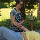 Sarah Wallace practices reiki on a client