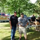 Minister of Communities, Land and Environment Robert Mitchell speaks with Eric Paynter of the Delta Waterfowl Chapter at Saturday's Youth Waterfowl Day.