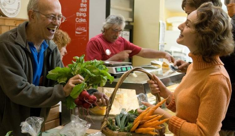 Famers' market vendor and customer interaction
