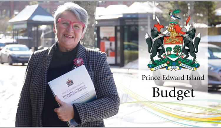 Image of Hon. darlene Compton, Minister of Finance holding 2021/21 budget