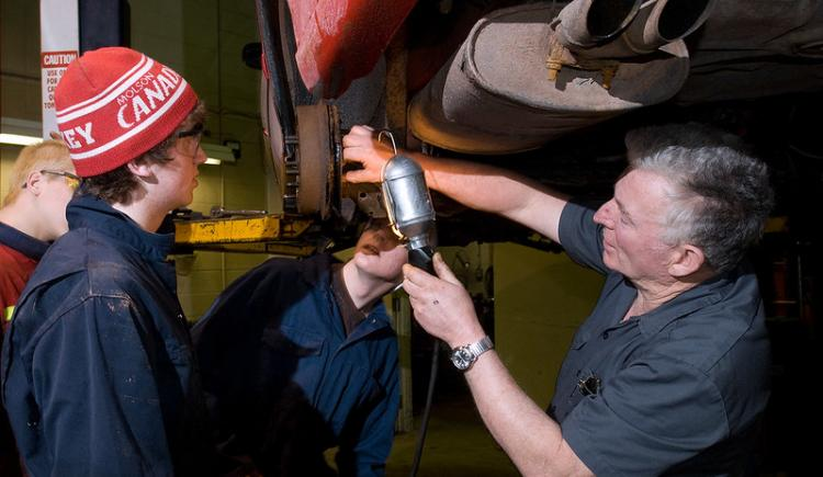 Apprentices learning about auto mechanics
