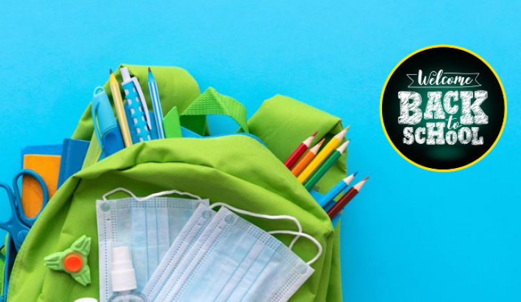 """Image of school backpack filled with school supplies including hand sanitizer and masks with graphic that reads """"Welcome Back to School"""""""