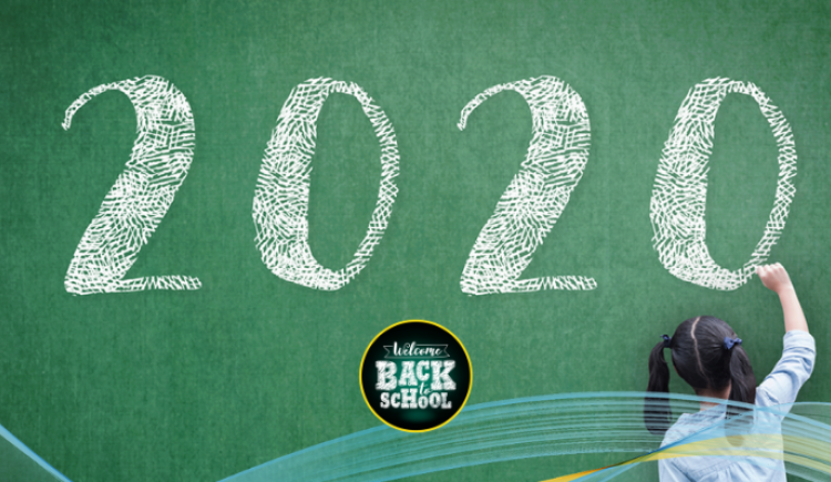 iStock image of female student writing 2020 on a chalkboard