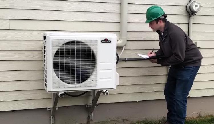 Energy efficient heat pump outside a PEI home