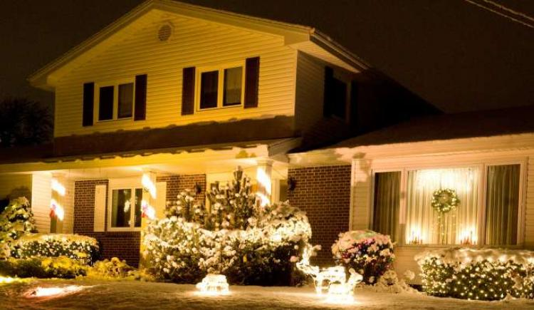 A PEI home in the winter with festive holiday lights