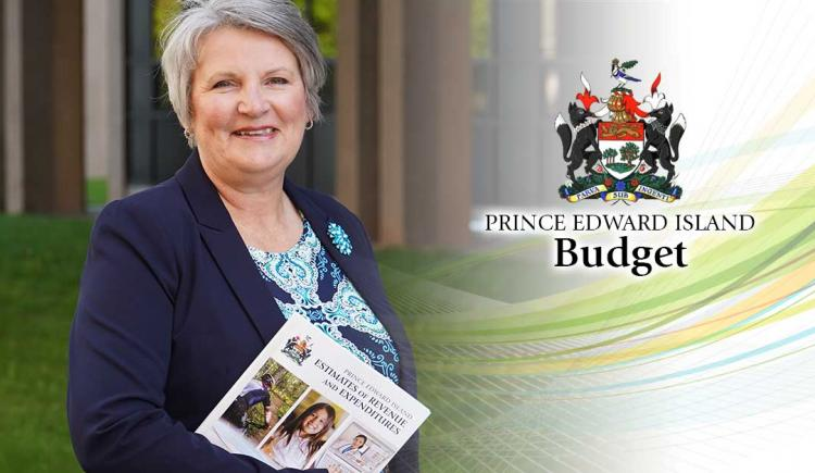 Image of Hon. darlene Compton, Minister of Finance holding 2020/21 budget