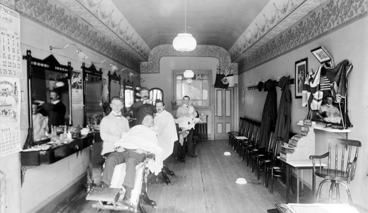 Interior view of Reardon's Barber Shop, Queen Street, Charlottetown, Prince Edward Island, 1899