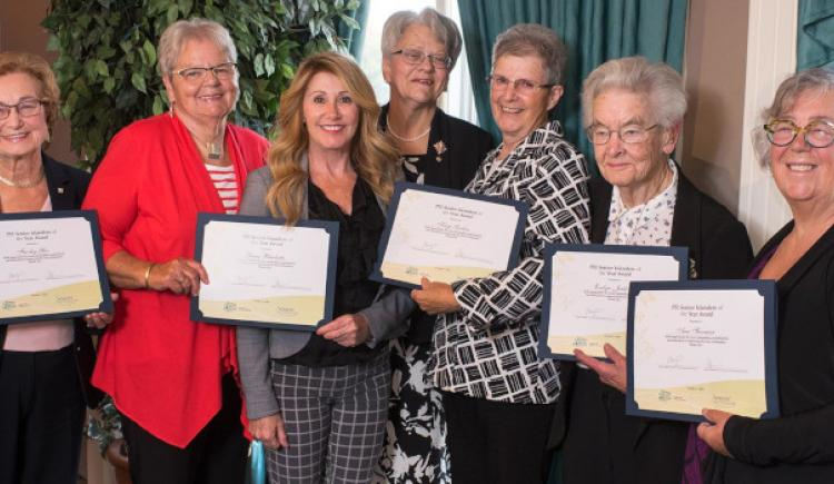 Image of the 2018 Senior Islanders of the Year with Minister Tina Mundy and Lt. Governor Antoinette Perry