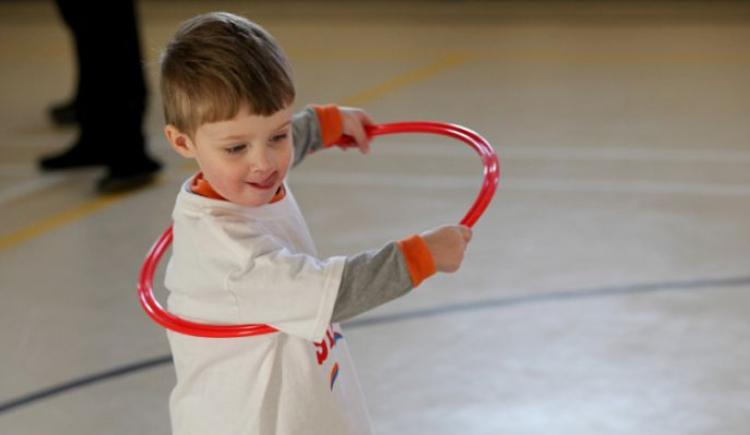 Boy playing with a hula hoop