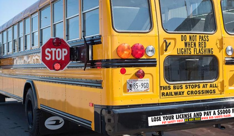 school bus with amber and red lights flashing