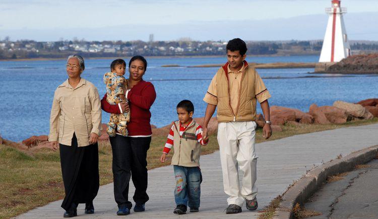 Multi-generational family walks on the boardwalk near Victoria Park