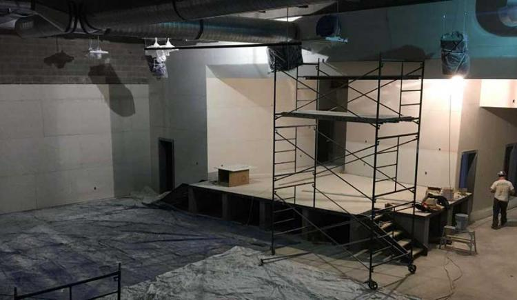Photo shows interior construction of a large space at the new French school.