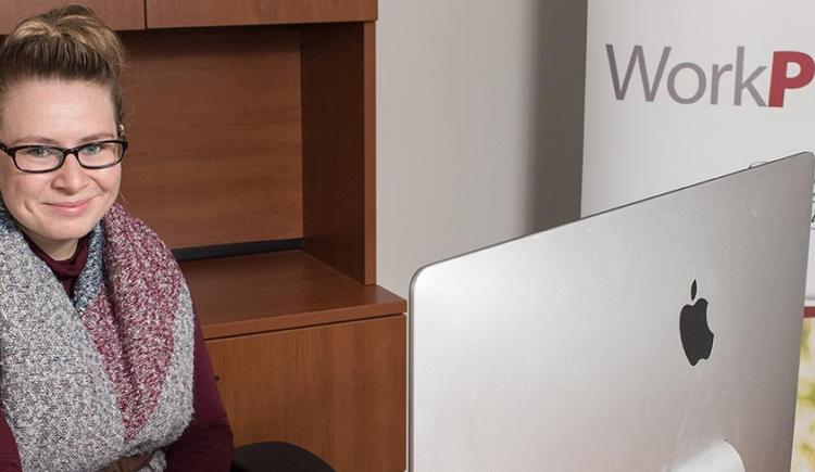 Amber James of Work PEI sitting at a desk