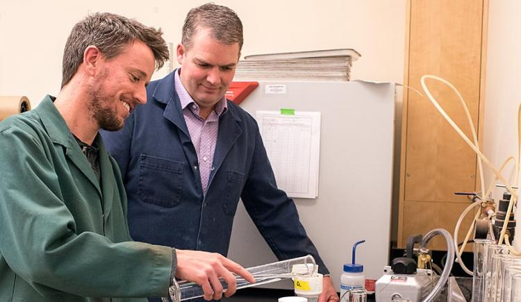Two people looking at lab equipment