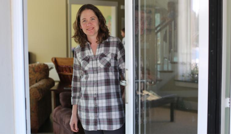 Beth Peters at her passive solar house in Long River