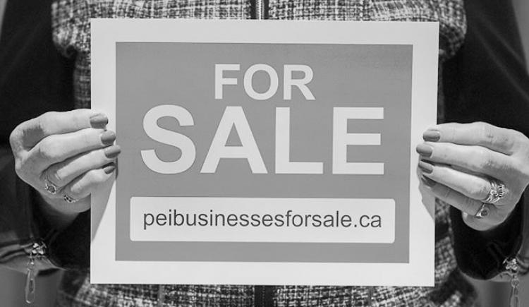 Image of woman holding a FOR SALE sign that lists the peibusinessesforsale.ca website address