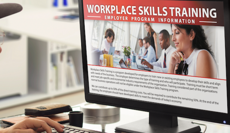 Man looking at Workplace Skills Training Info on Computer