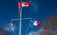 Image of PEI flag, Canada flag and Acadian flag at Government House