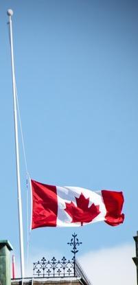 iStock image of Canada flag flying at half-mast
